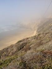 A foggy shoreline